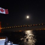 Sailing out under the Golden Gate Bridge just as the moon is rising