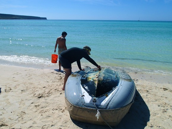 Tom helping scrape the bottom of the dinghy